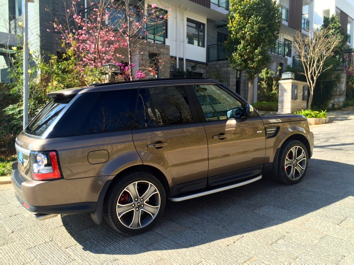 Another neighbor with their new Range Rover parked outside.