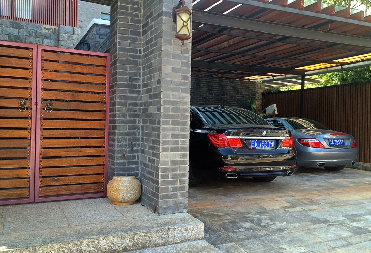 One of our neighbors with their BMW and Mercedes in the carport.