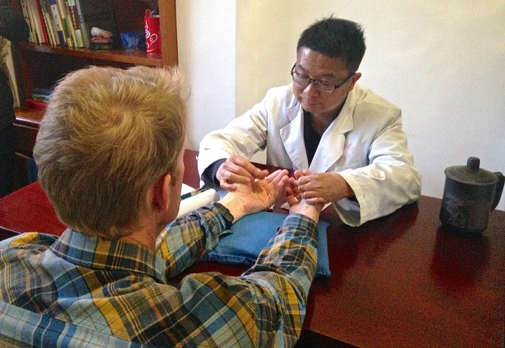 "Traditional Chinese doctor preparing to ""check my pulse"" (bamai)"